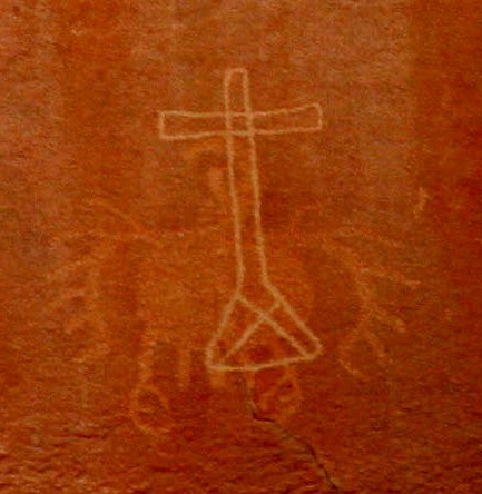 Condor; fragment of pre-Columbian rock art engraving in the Atacama Desert, Chile. The cross was painted centuries after,  presumably by catholic missionaries. Photo: Ximena Jordan.